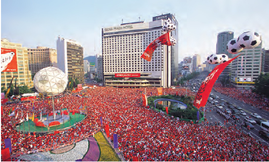 Red Devils' take to the Streets. After their enthusiastic support for their national team in red T shirts during the 2002 FIFA World Cup Korea/Japan, South Korean sports fans acquired the nickname Red Devils. It is said that about half of all South Koreans took part in the supporting events during the 2002 tournament. South Koreans supporting the national team in front of Seoul City Hall during the 2002 FIFA World Cup Korea/Japan. Many foreigners said that they were deeply impressed by the fans' enthusiasm and unity.